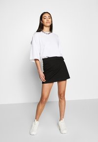 Weekday - PAGE MINI SKIRT - Áčková sukně - black - 1