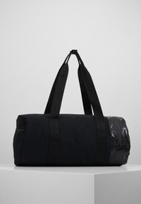 adidas by Stella McCartney - ROUND DUFFEL S - Sports bag - black/black/white - 2