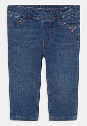 ORIGINAL SHIELD BABY UNISEX - Slim fit jeans - blue denim