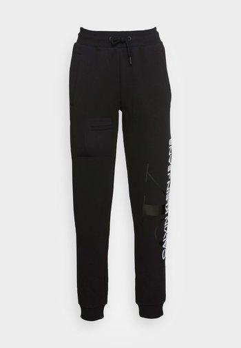 VERTICAL MONOGRAM JOG PANTS - Pantaloni sportivi - black