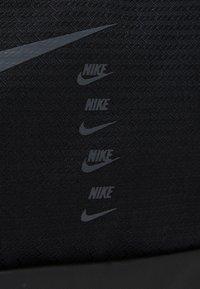Nike Performance - DUFF UNISEX - Sports bag - black - 4