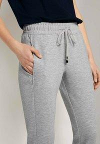 TOM TAILOR - Tracksuit bottoms - comfort grey melange - 3
