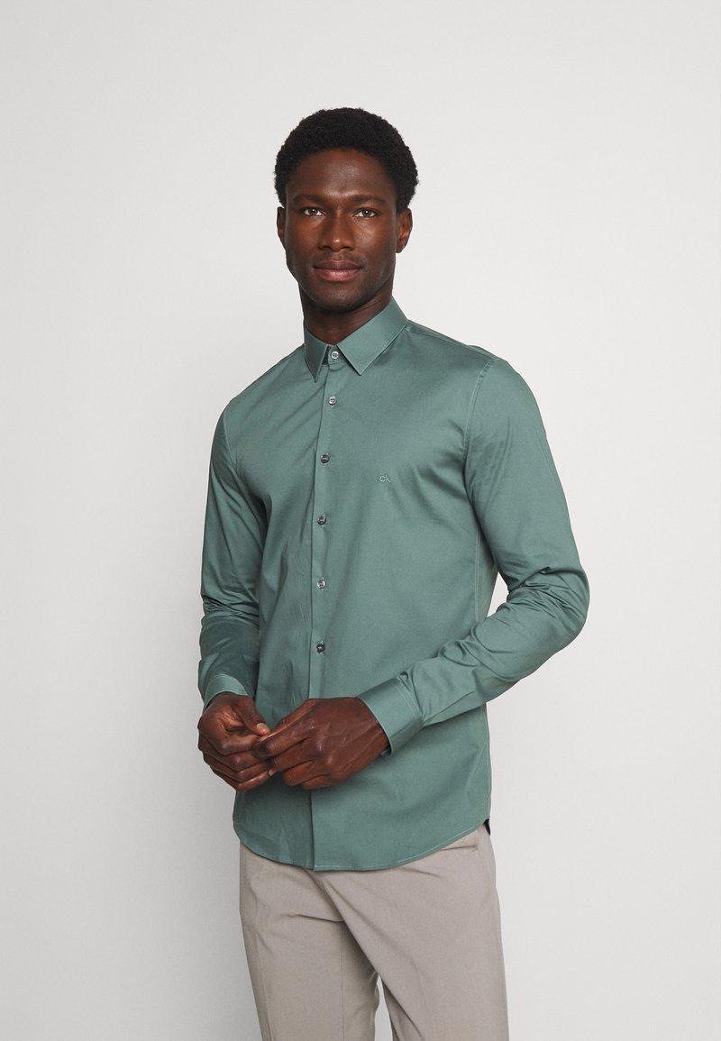 Calvin Klein Tailored - LOGO STRETCH EXTRA SLIM - Formal shirt - balsam green