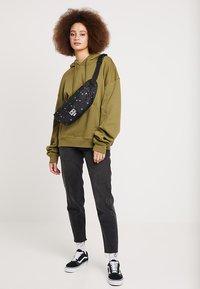 Obey Clothing - DROP OUT SLING PACK - Bum bag - symbol black - 5