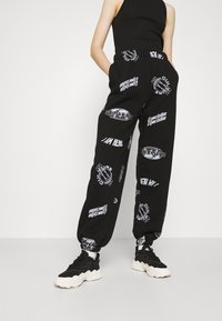 Topshop - VIRTUAL REALITY - Tracksuit bottoms - black - 0