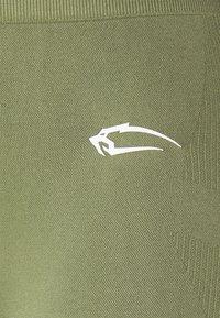 Smilodox - SEAMLESS LEGGINGS COOL - Tights - khaki - 6