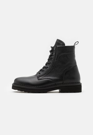 LACE UP BOOT - Lace-up ankle boots - black
