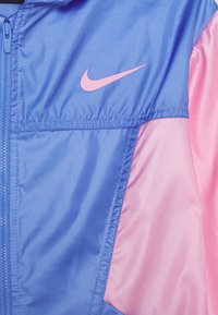 Nike Performance - ESSENTIAL - Training jacket - royal pulse/pink