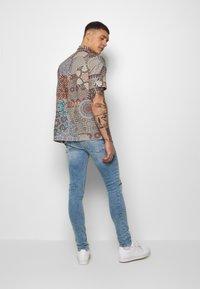 Topman - RIP SPRAY - Jeans slim fit - blue - 2