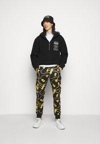Versace Jeans Couture - Spodnie treningowe - black - 1