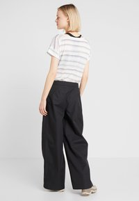 Didriksons - MALVINA WOMEN'S PANTS - Outdoor trousers - black - 2