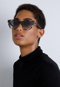 Prada - Sunglasses - brown/black - 1