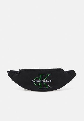 WAISTBAG GLOW UNISEX - Bum bag - black