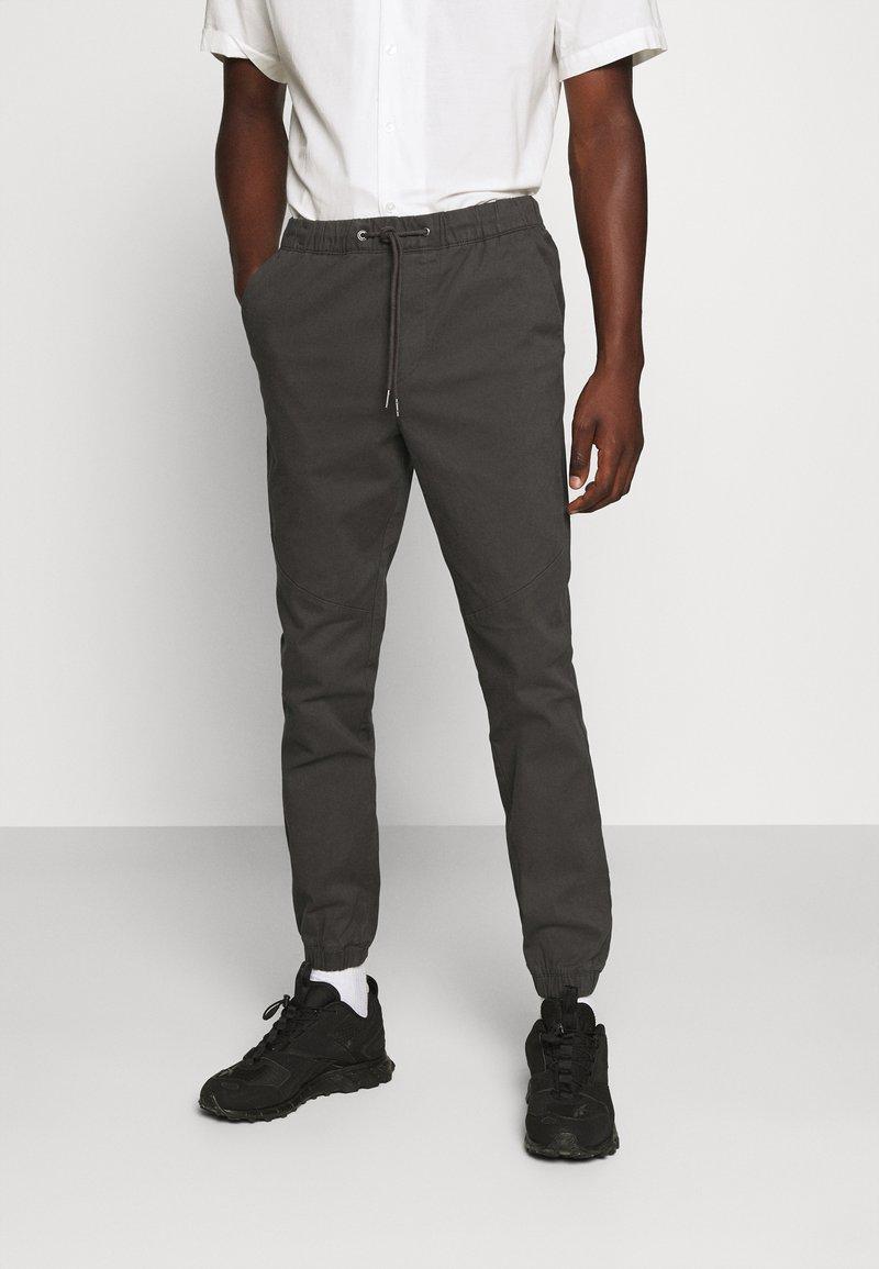 Jack & Jones - JJIVEGA JJJOGGER - Trousers - dark grey