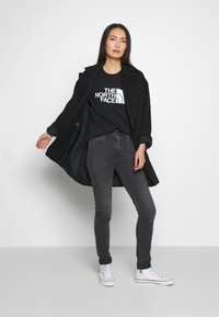 The North Face - EASY TEE - Print T-shirt - black - 1