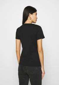 Tommy Hilfiger - SLIM ROUND NECK - Basic T-shirt - black - 2