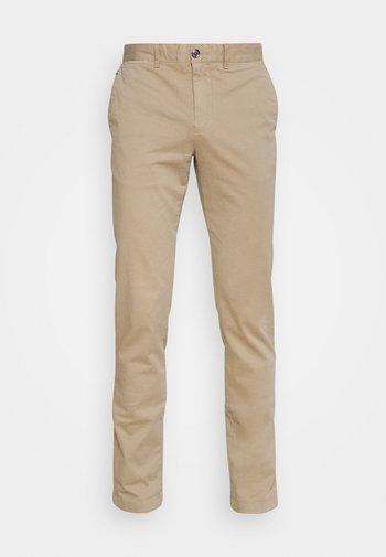 BLEECKER FLEX - Trousers - beige