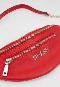 Guess - CALEY BELT BAG - Rumpetaske - red - 2