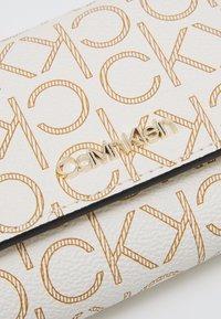 Calvin Klein - TRIFOLD XS MONOGRAM - Wallet - white - 3