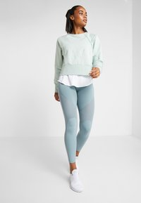 Nike Performance - DRY GET FIT LUX - Mikina - pistachio frost - 1