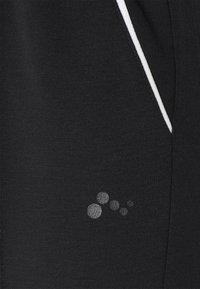 ONLY Play - ONPJODINA - Tracksuit bottoms - black/white - 6