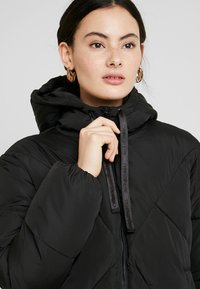 Calvin Klein Jeans - QUILTED PUFFER JACKET - Winter jacket - black - 4