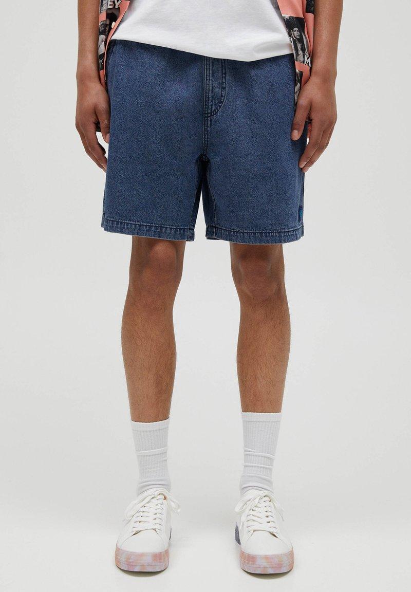 PULL&BEAR - Jeans Short / cowboy shorts - blue black denim