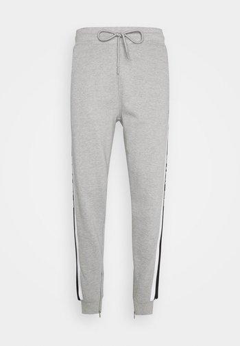 UNISEX TAPE LOGO - Tracksuit bottoms - heather grey