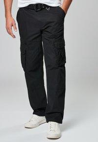 Next - TECH - Cargo trousers - black - 0