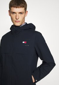 Tommy Hilfiger - HOODED JACKET - Waterproof jacket - blue - 3