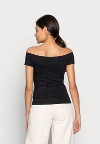 Calvin Klein Jeans - MONOGRAM SLIM BARDOT TOP - Print T-shirt - black - 2