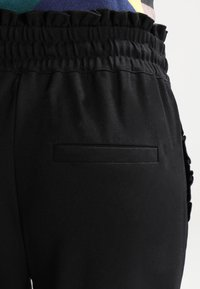 ONLY - ONLPOPTRASH  - Trousers - black - 4
