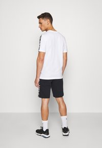 Puma - AMPLIFIED SHORTS - Pantaloncini sportivi - black - 2