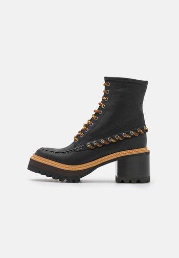 MAHALIA - Lace-up ankle boots - black