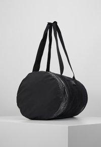 adidas by Stella McCartney - ROUND DUFFEL S - Sports bag - black/black/white - 3