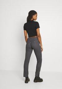 WAL G. - PIN STRIPE SKINNY TROUSERS - Trousers - black/white - 2