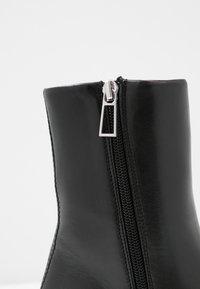 Filippa K - EILEEN BOOT - Kotníkové boty - black - 2