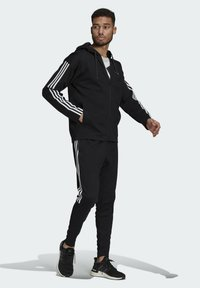 adidas Performance - ADIDAS SPORTSWEAR RIBBED INSERT TRACKSUIT - Survêtement - black - 1