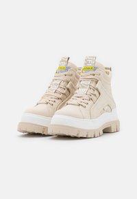 Buffalo - VEGAN ASPHA MID - Platform ankle boots - beige - 2