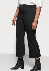 Even&Odd Curvy - Flared PUNTO trousers - Spodnie materiałowe - black - 3