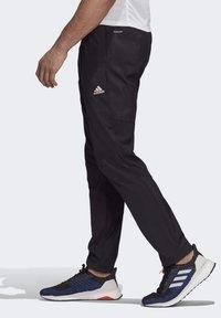 adidas Performance - ADAPT JOGGERS - Träningsbyxor - black - 3