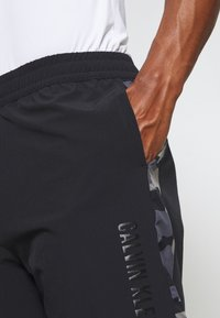 Calvin Klein Performance - SHORTS - Sports shorts - black - 4
