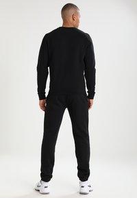 Lacoste Sport - Spodnie treningowe - black - 2