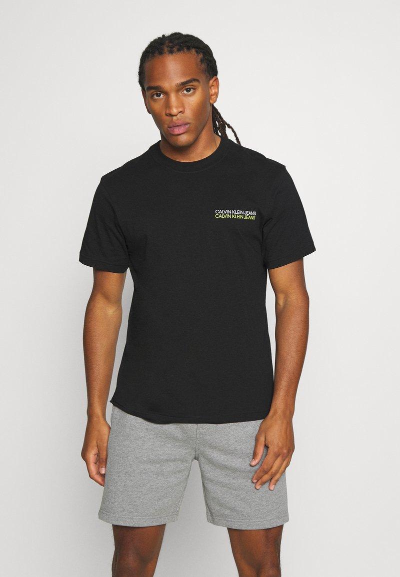 Calvin Klein Jeans - SKATER PHOTO NEON TEE - Print T-shirt - black