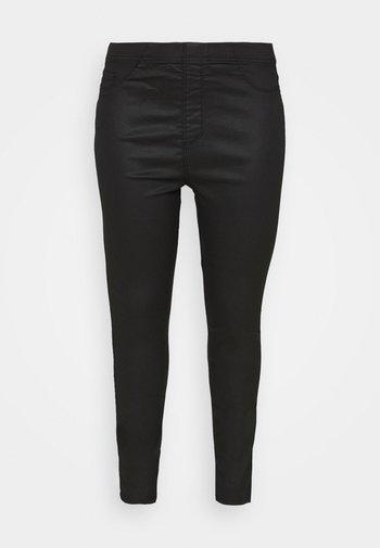 COATED - Leggings - Trousers - black
