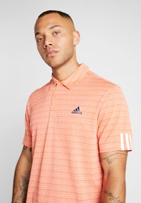 adidas Golf - STRIPE COLLECTION - Poloshirts - amber tint/signal coral - 4