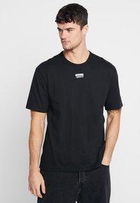 adidas Originals - REVEAL YOUR VOICE TEE - Basic T-shirt - black - 0