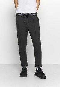 Calvin Klein Jeans - Tracksuit bottoms - mottled black - 0