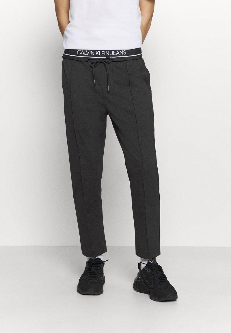 Calvin Klein Jeans - Pantaloni sportivi - mottled black