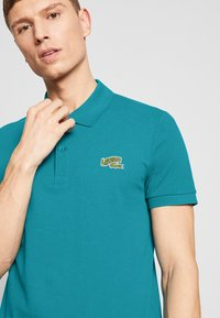 Lacoste - PH5144 - Polo shirt - turquoise - 3